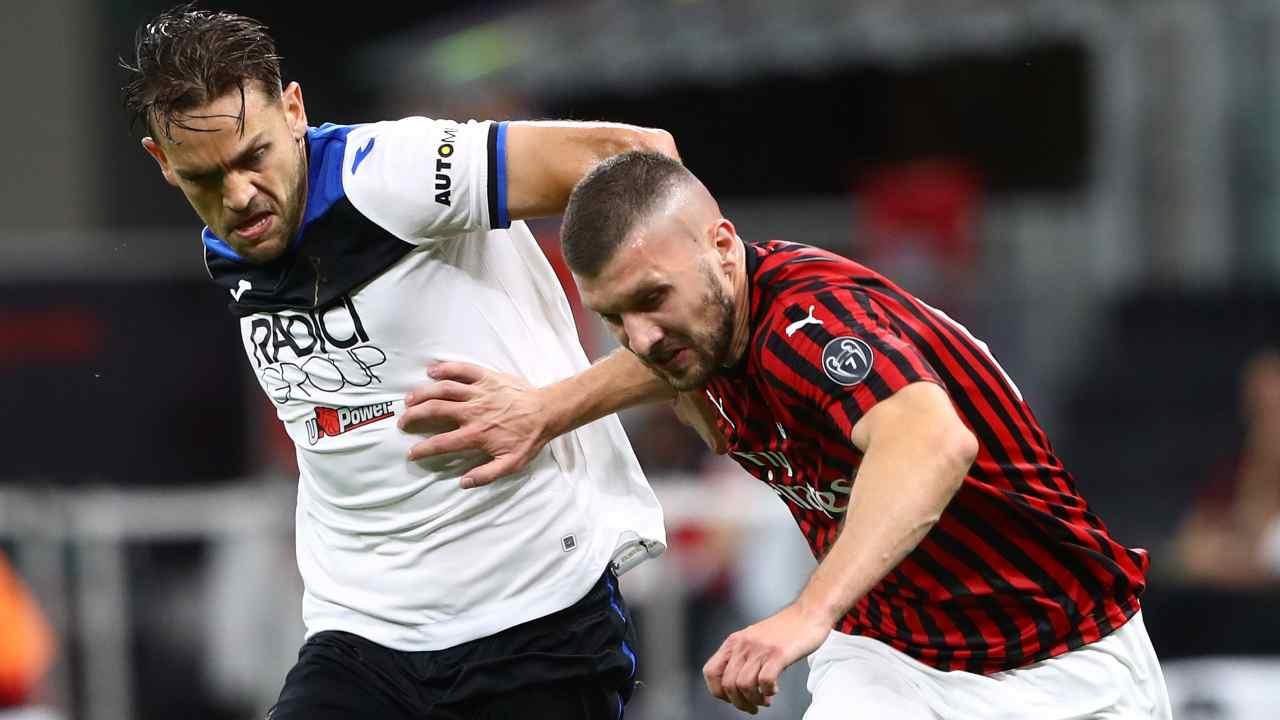 Da sinistra: il difensore Rafael Toloi e l'attaccante Ante Rebic, 24 luglio 2020 (foto di Marco Luzzani/Getty Images)